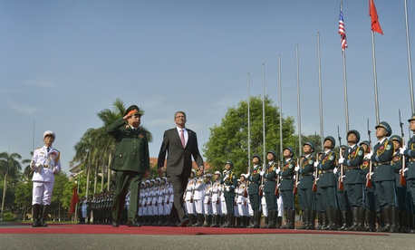 Secretary of Defense Ash Carter is welcomed with an honor cordon by Vietnamese Minister of Defense General Phung Quang Thanh n Hanoi, Vietnam, June 1, 2015.