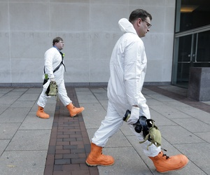 Firefighters in protective clothing prepare to enter the U.S. Courthouse in Philadelphia Wednesday, Feb. 20, 2013.