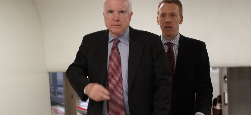 Sen. John McCain, R-Ariz., and a staff member walk on Capitol Hill in Washington, Wednesday, Feb. 25, 2015.