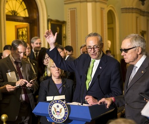 Sen. Charles Schumer, D-N.Y., flanked by Sen. Patty Murray, D-Wash., and Senate Minority Leader Harry Reid of Nev. speaks with reporters on Capitol Hill in Washington, Tuesday, May 5, 2015.