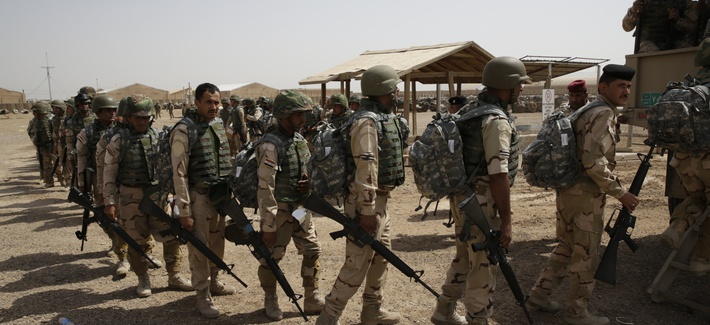 Soldiers from the 76th Iraqi Army Brigade prepare to load a truck with their new M16A2 rifles and military equipment at the Taji Military Complex, Iraq, May 24, 2015.