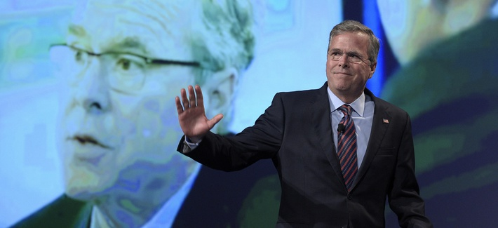 Former Florida Gov. Jeb Bush waves while walking on the stage to speak at Rick Scott's Economic Growth Summit in Lake Buena Vista, Fla., Tuesday, June 2, 2015.