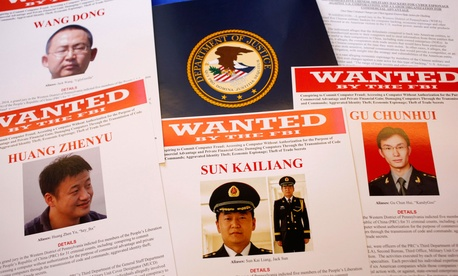 In this May 19, 2014, file photo, press materials are displayed on a table of the Justice Department in Washington.