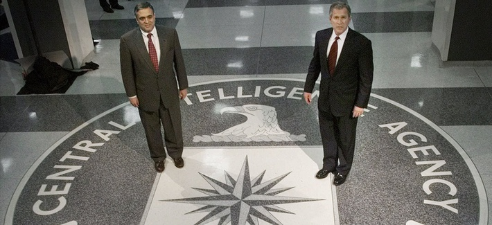 Then President George Bush (R) stands with then-CIA Director George Tenet, on March, 20, 2001.