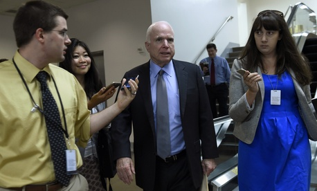 Sen. John McCain, R-Ariz., is pursued by reporters on Capitol Hill in Washington, Thursday, June 4, 2015.