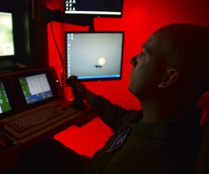 Tech. Sgt. Jason, 91st Attack Squadron sensor operator, flies a simulated training mission on an MQ-9 Reaper at Creech Air Force Base, Nev., May 8, 2014.