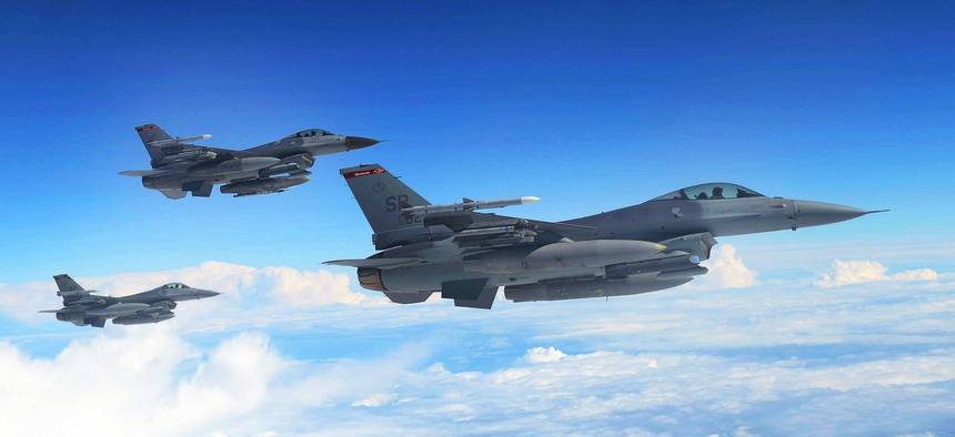U.S. Air Force F-16 Fighting Falcons await refueling from a KC-135 Stratotanker assigned to the 351st Expeditionary Air Refueling Squadron-Poland June 13, 2014.