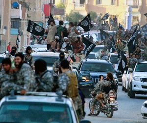 Fighters from the Islamic State group parade in Raqqa, north Syria, on June 19,2014.