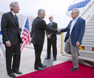 Former Defense Secretary Chuck Hagel shakes hands with Director General of the Israeli Ministry of Defense Udi Shani, as former Israeli Ambasssador to the U.S. Michael Oren looks on.