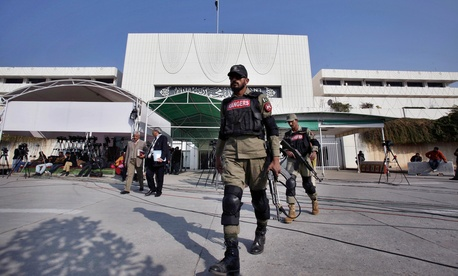 Pakistani paramilitary soldiers patrol at the premises of National Assembly building during an assembly session Tuesday, Jan. 6, 2015 in Islamabad, Pakistan, Tuesday, Jan. 6, 2015.