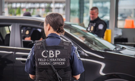 A CBP officer looks on at the 100 percent outbound inspection taking place at the Area Port of Champlain on June 15, 2015.