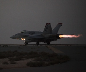 A U.S. Marine Corps F/A-18 Hornet launches for a strike mission in Southwest Asia, June 10, 2015.