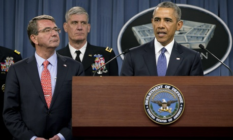 President Barack Obama, right, speaks to the media after receiving an update from military leaders on the campaign against the Islamic State, during a rare visit to the Pentagon on Monday, July 6, 2015.