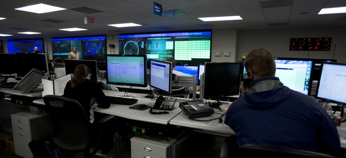 Specialists work at the National Cybersecurity and Communications Integration Center (NCCIC) in Arlington, Va., Tuesday, Sept. 9, 2014.