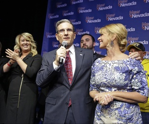 Rep. Joe Heck, R-Nev., gives a victory speech with his wife Lisa Heck, right, after defeating Erin Bilbray to keep his seat in Congress Tuesday, Nov. 4, 2014, in Las Vegas.