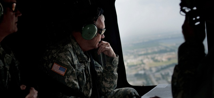 Gen. Martin E. Dempsey above the Mississippi River and its levee system, May 21, 2011.