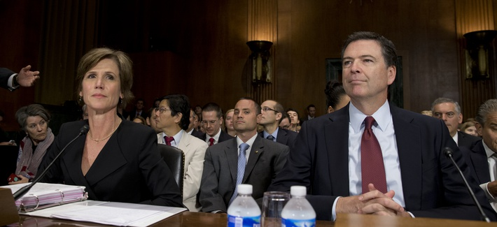 FBI Director James Comey, right, and Deputy Attorney General Sally Quillian Yates, are seated as they arrive to testify at the Senate Judiciary Committee hearing on Capitol Hill in Washington, Wednesday, July 8, 2015.