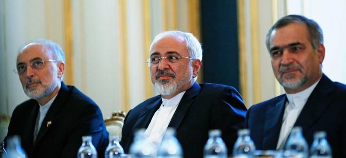 Iranian Foreign Minister Javad Zarif, centre, Head of the Iranian Atomic Energy Organization Ali Akbar Salehi, left, and Hossein Fereydoon, brother and close aide to President Hassan Rouhani meet with Secretary of State John Kerry, on July 3, 2015.