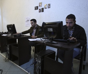 In this picture taken on Tuesday, Jan. 18, 2011, Iranian journalism students use computers in an internet cafe in central Tehran, Iran.