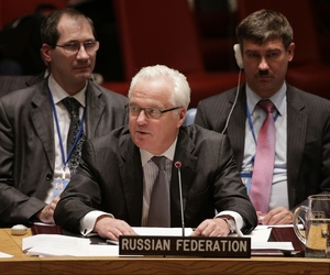 Russian permanent resident to the United Nations, Vitaly Churkin, center, speaks to the U.N. Security Council, Friday, Sept. 19, 2014.