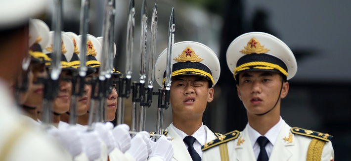 Members of a Chinese honor guard prepare for a welcome ceremony for the Belgium King in Beijing, Tuesday, June 23, 2015.