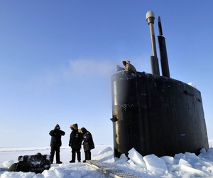 Members of the Applied Physics Laboratory Ice Station clear ice from the hatch of the Los Angeles-class submarine USS Annapolis after the sub broke through the ice while participating in Ice Exercise 2009 in the Arctic Ocean.