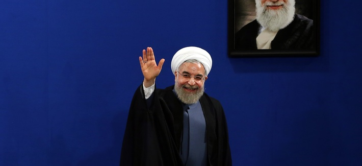 Iran's President Hassan Rouhani waves to reporters at the conclusion of his press conference on the second anniversary of his election, in Tehran, Iran, Saturday, June 13, 2015.