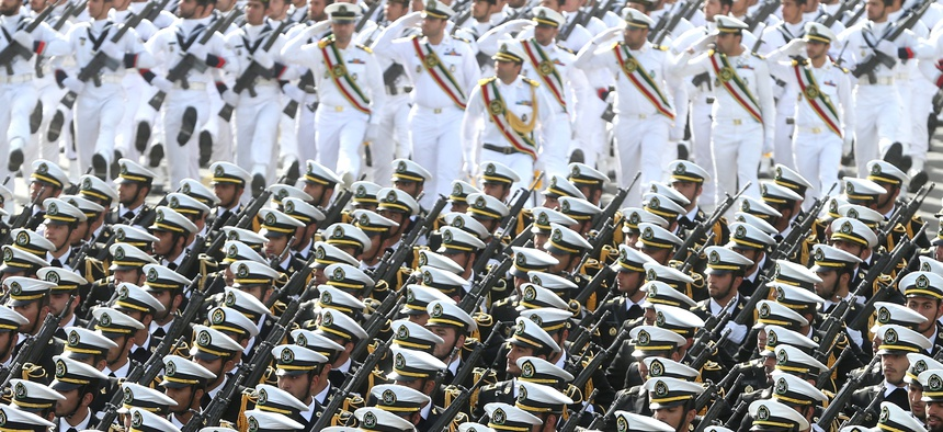 Iranian navy troops march in a parade marking National Army Day in front of the mausoleum of the late revolutionary founder Ayatollah Khomeini, just outside Tehran, Iran, Saturday, April 18, 2015.