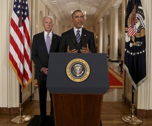 President Barack Obama, standing with Vice President Joe Biden, delivers remarks in the East Room of the White House in Washington, Tuesday, July 14, 2015.