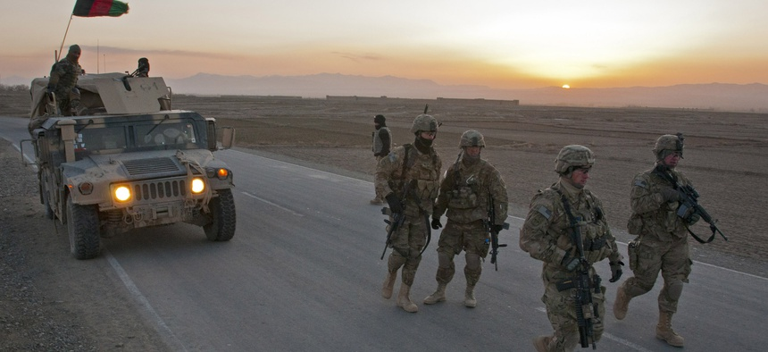 US Army soldiers from Task Force Blackhawk set up a traffic checkpoint at Combat Outpost Yosef Khel, on March 8, 2012.