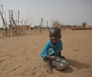 A 2 year old child eats dry couscous in the village of Goudoude Diobe, Senegal., on May 1, 2012.