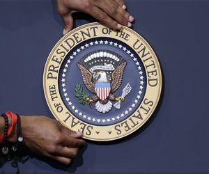 The presidential seal is placed on the podium ahead of President Barack Obama's visit to Lackawanna College Friday, Aug. 23, 2013, in Scranton, Pa.