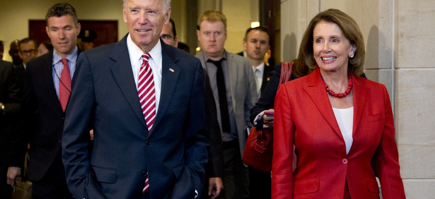 Vice President Joe Biden and House Minority Leader Nancy Pelosi of Calif., leave a meeting with the House Democratic Caucus to discuss the Iran nuclear deal, Wednesday, July 15, 2015.