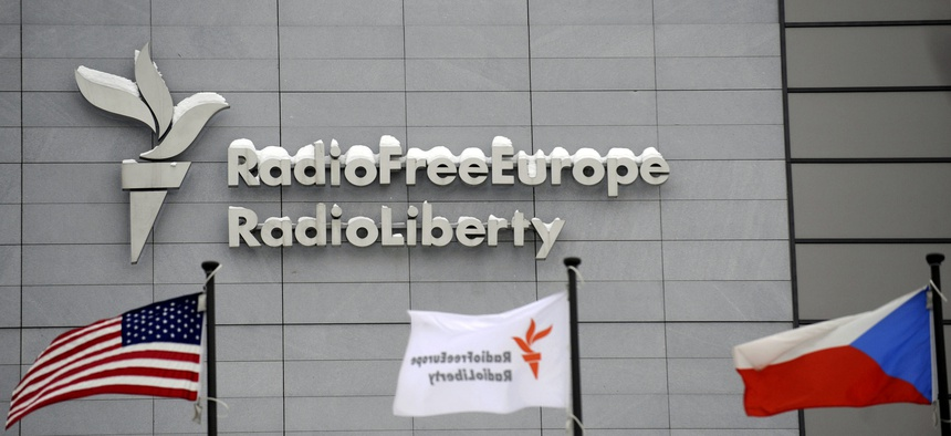 The headquarters of Radio Free Europe/Radio Liberty (RFE/RL) seen with the United States, RFE/RL and the Czech Republic flags in the foreground, in Prague Friday, Jan. 15, 2010.