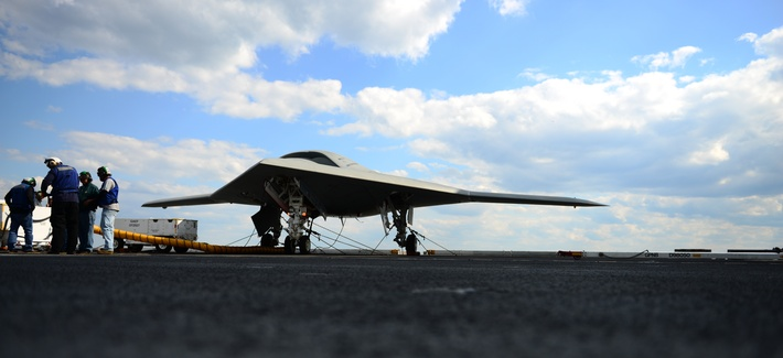 Northrop Grumman personnel conduct pre-operational tests on an X-47B Unmanned Combat Air System demonstrator on the flight deck of the aircraft carrier USS George H.W. Bush, on May 13, 2013.