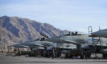 Royal Air Force No. 6 Squadron Typhoon FGR-4s, from RAF Leachars, United Kingdom, park on the Nellis Air Force Base, Nev., flightline Jan. 28, 2014.