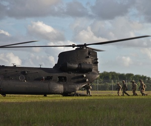 Army Rangers of 1st Battalion, 75th Ranger Regiment, prepare to enter an MH-47 helicopter to execute fast rope training at Hunter Army Airfield, Ga. June 2, 2014.