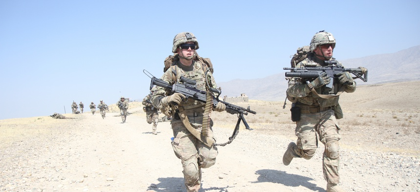 Third Brigade Combat Team, 101st Airborne Division soldiers sprint to their objective during a platoon live-fire training exercise July 3, 2015 at Tactical Base Gamberi in eastern Afghanistan.