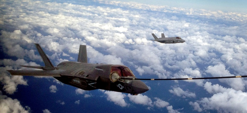 Two F-35B Joint Strike Fighters conduct the first aerial refueling of its kind with a KC-130J Hercules in the sky above Eglin Air Force Base, Fla., Oct. 2. 2012.