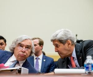 Energy Secretary Ernest Moniz, left, and Secretary of State John Kerry talk on Capitol Hill in Washington, Tuesday, July 28, 2015.