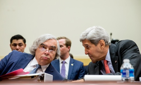 Energy Secretary Ernest Moniz, left, and Secretary of State John Kerry talk on Capitol Hill in Washington, Tuesday, July 28, 2015.