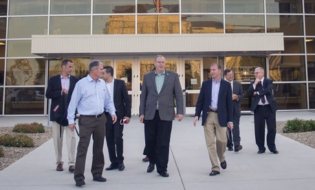 Deputy Defense Secretary Robert Work walks with defense officials outside of the Pentagon's Defense Innovation Unit-Experimental in Silicon Valley.