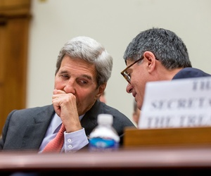 Secretary of State John Kerry, left, speaks with Treasury Secretary Jacob Lew, as they testify on Capitol Hill in Washington, July 28, 2015.