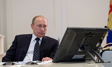 Russian President Vladimir Putin attends a video conference on commissioning military products in the situation center in the Kremlin in Moscow, Russia, Thursday, July 16, 2015.