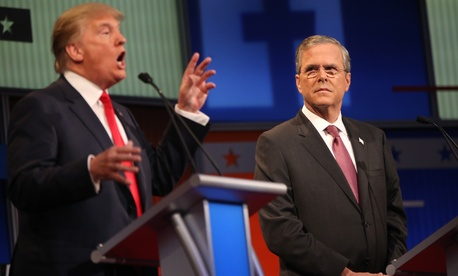 Republican presidential candidate Jeb Bush listens as Donald Trump speaks during the first Republican presidential debate at the Quicken Loans Arena Thursday, Aug. 6, 2015, in Cleveland.