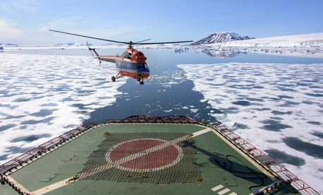 A helicopter lifts off the deck of the Russian nuclear-powered icebreaker 50 Years of Victory in the Arctic Sea on July 5, 2015. Used under Creative Commons Attribution 2.0 Generic.