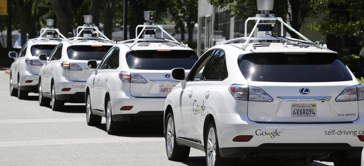 A row of Google self-driving cars parked in Mountain View, Calif., last year.