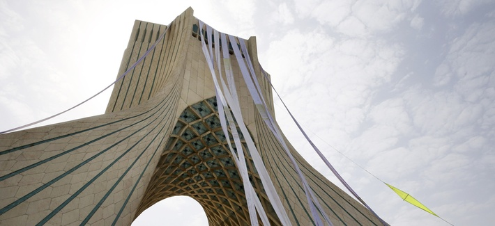 """Petition scrolls hang from the Azadi (Freedom) tower during a demonstration of a group of hard-liners demanding Iranian nuclear negotiators to sign a """"good deal"""" with 5+1 countries that reserves rights of the Iranian nation, in Tehran, Iran, Tuesday, June"""