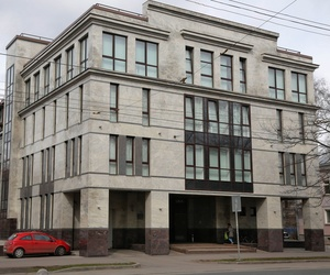"In this picture taken on Sunday, April 19, 2015, a women enters the four-story building known as the ""troll factory"" in St. Petersburg, Russia."