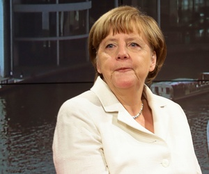 Angela Merkel prepares in a studio before a television appearance  in July.